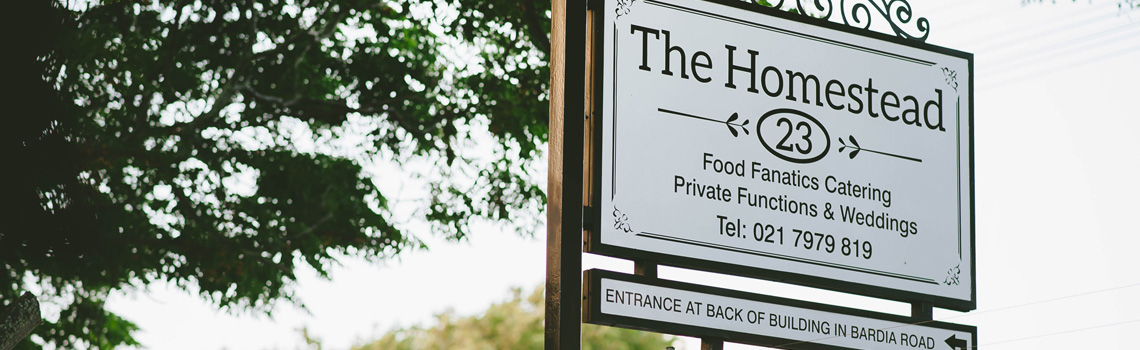 Signage outside The Homestead Cape Town offering catering, private functions, weddings and more.