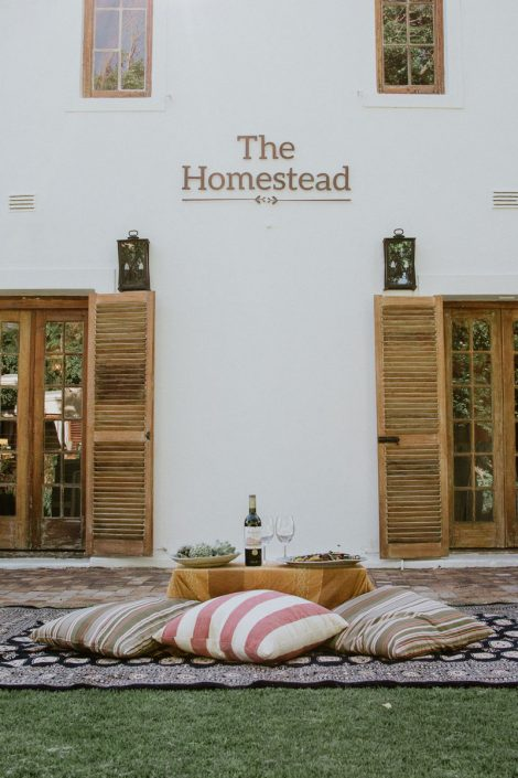 The Homestead logo, overlooking a picnic.