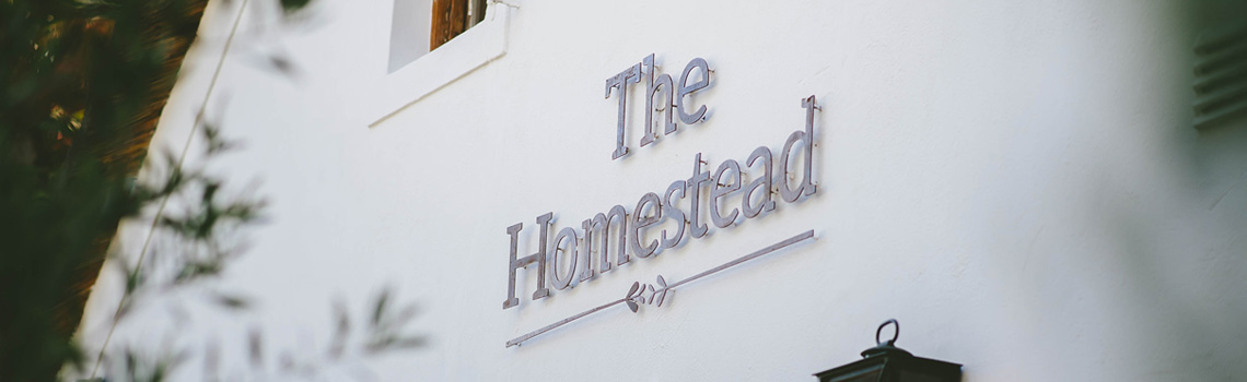 The Homestead Logo on the side of The Homestead Venue Cape Town